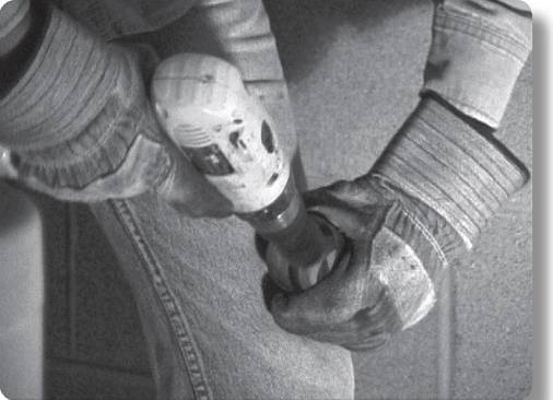 worker holding a power cleaning tool