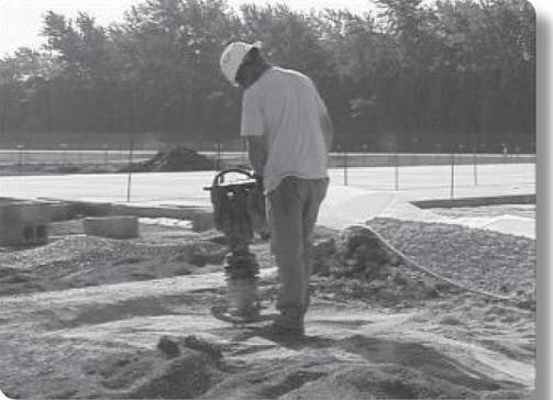 worker using power vibration tool