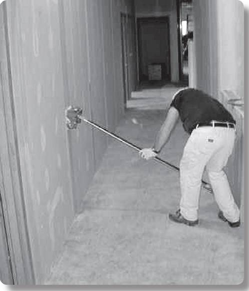 worker using a spring powered finishing tool