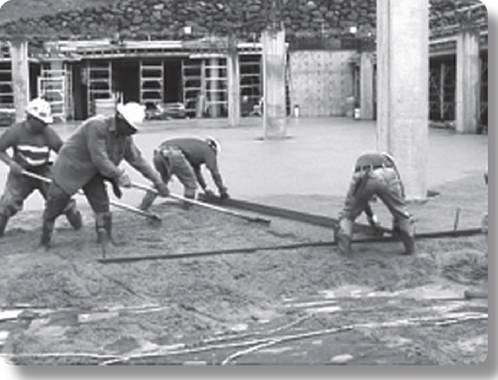 workers engaged in hand screeding
