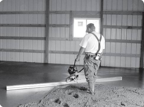 worker using a motorized screed